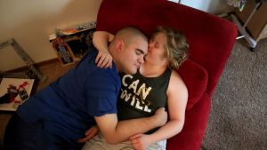 Rachel Larson and Nicholas Hamilton enjoy some quiet time in the living room of Larson's family's home before going on a ...